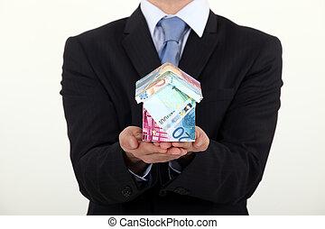 argent, fait, homme affaires, tenue, maison