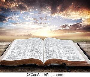 bible ouverte, coucher soleil