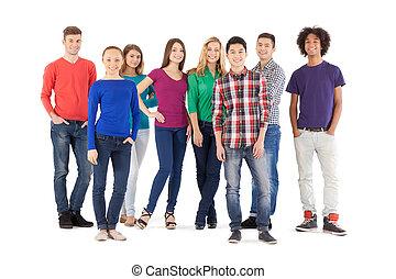 debout, entiers, gens, gens., isolé, jeune, gai, quoique, appareil photo, désinvolte, longueur, blanc, sourire