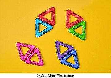 magnétique, bâtiment, fond, jaune, coloré, blocs, vue dessus