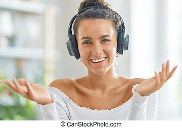 utilisation, jeune femme, headphones.